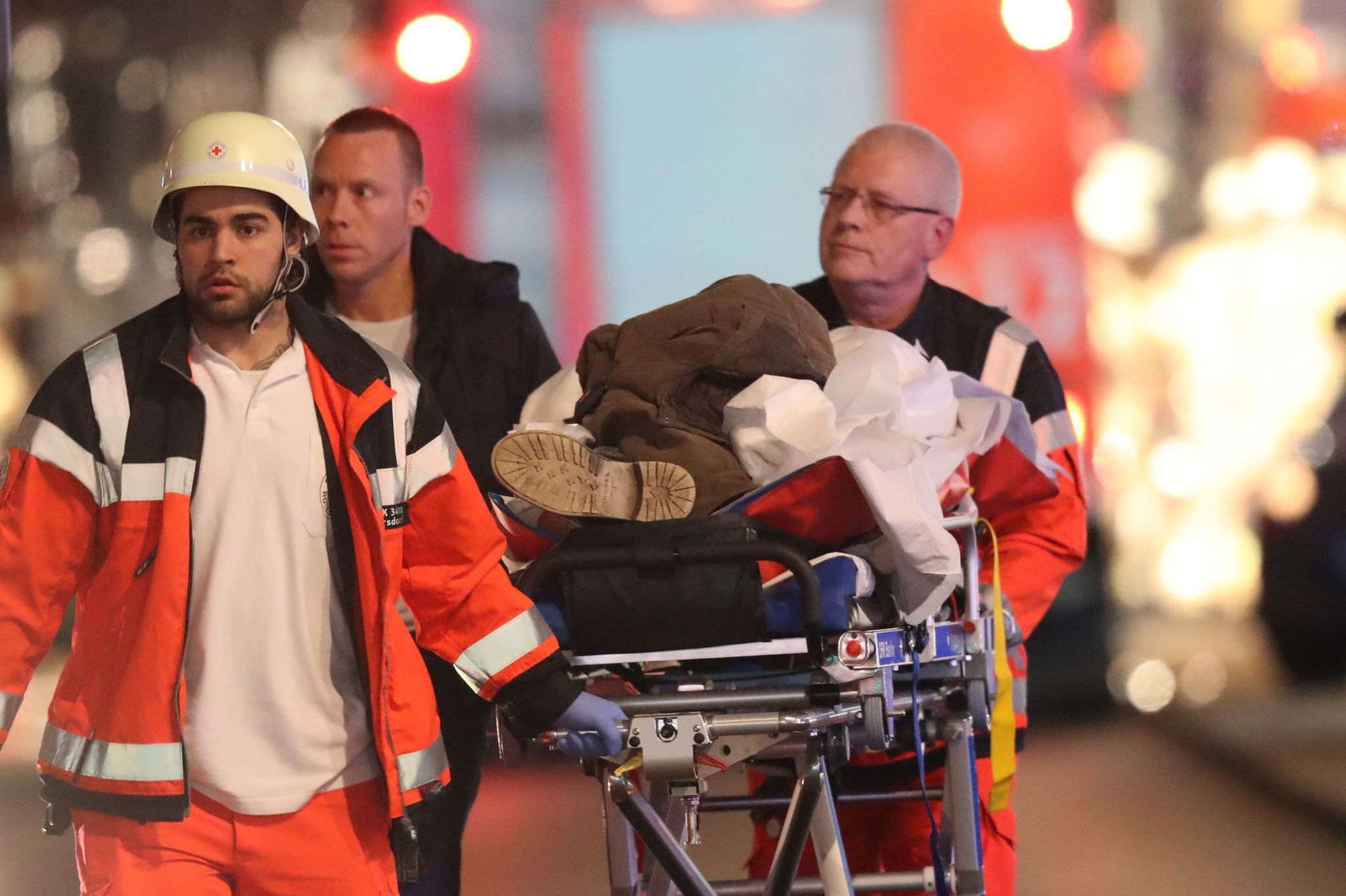 Emergency workers with an injured person in Berlin, 19 December