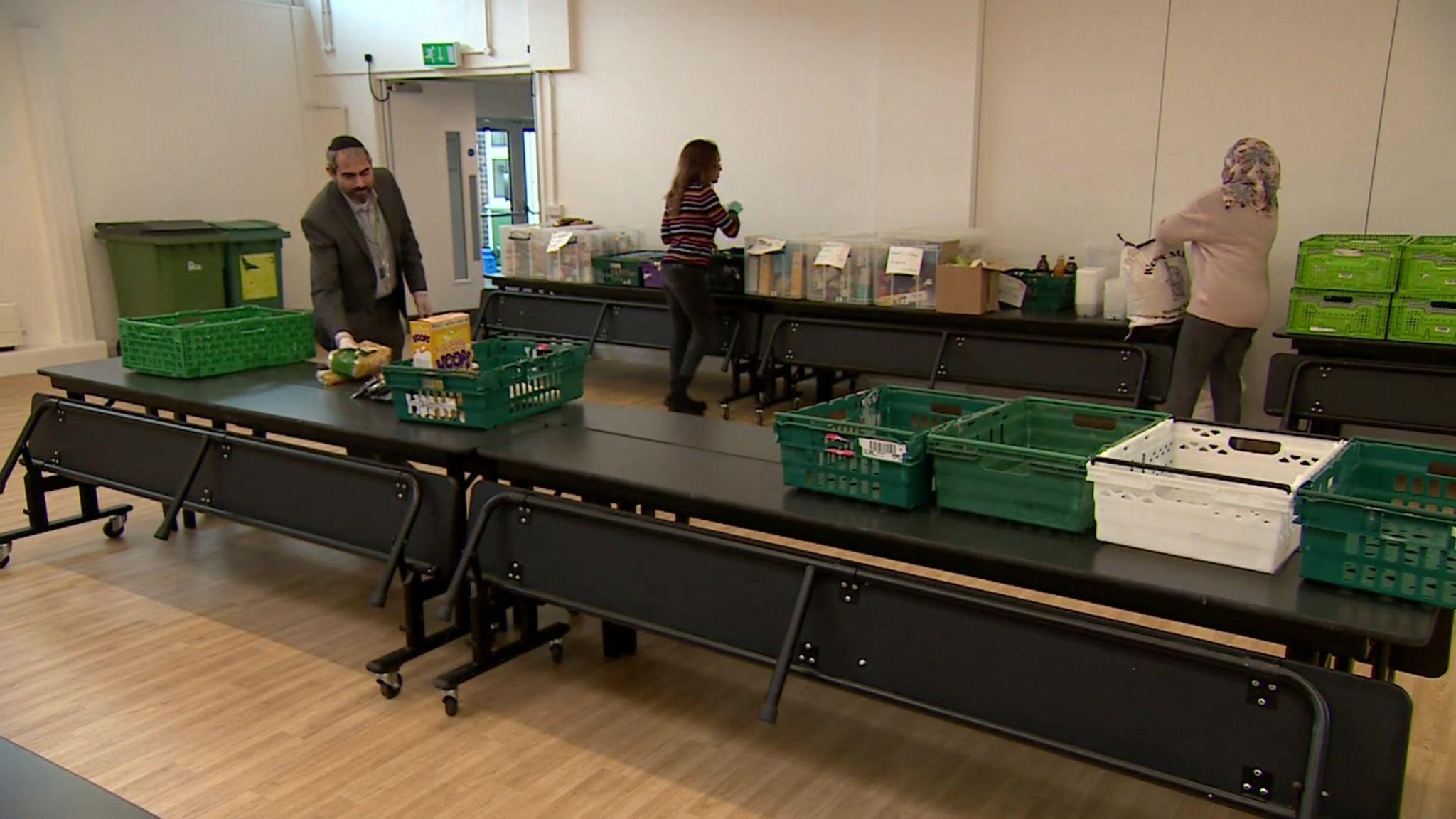 Teachers packing food parcels