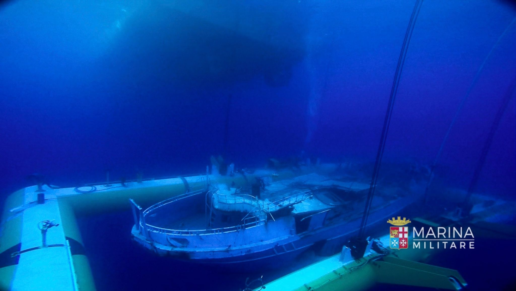 A fishing boat was attached to a cradle in order to lift it from the sea bed