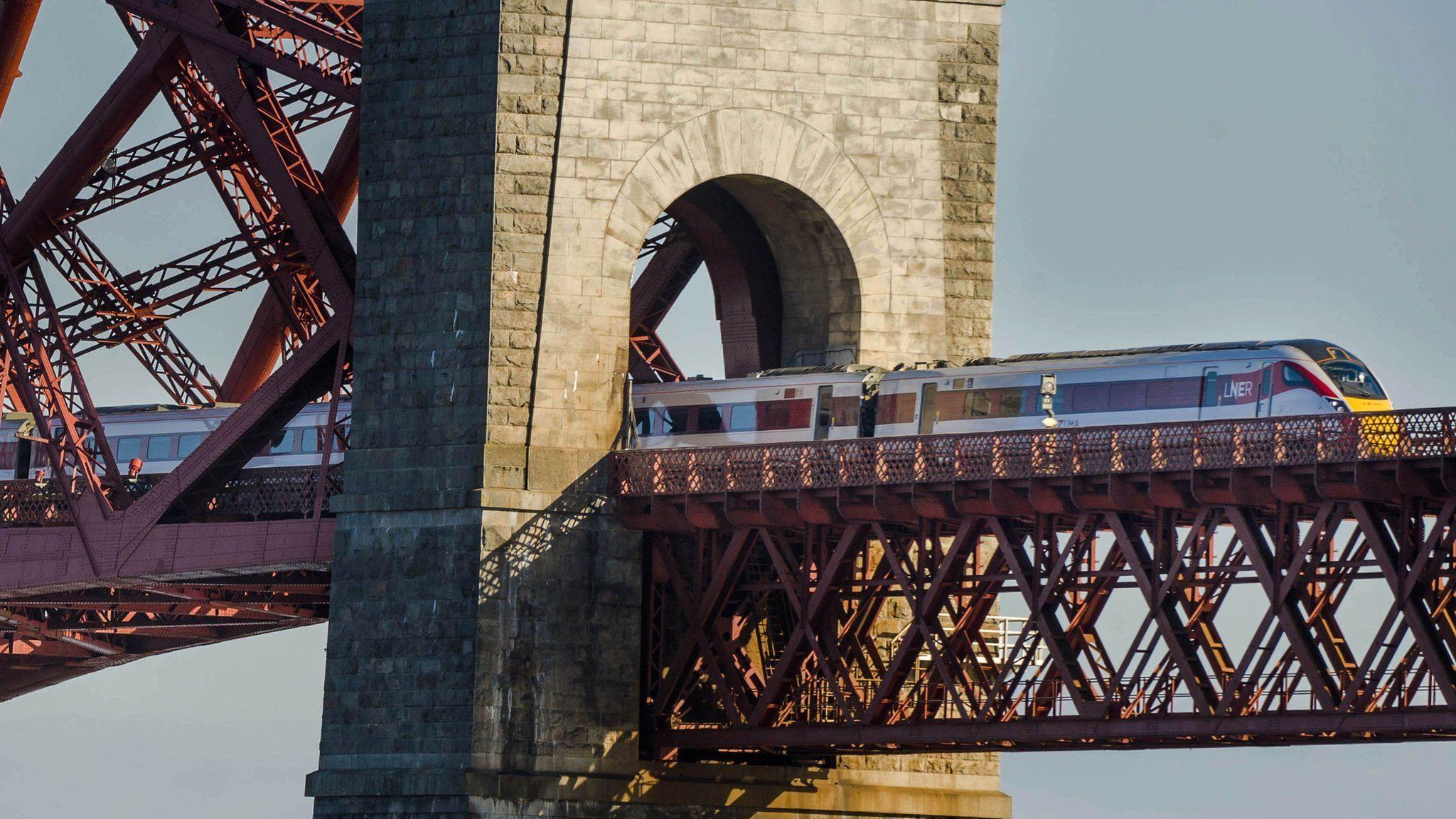 Hitachi Class 800 train crosses the Forth Bridge in Edinburgh