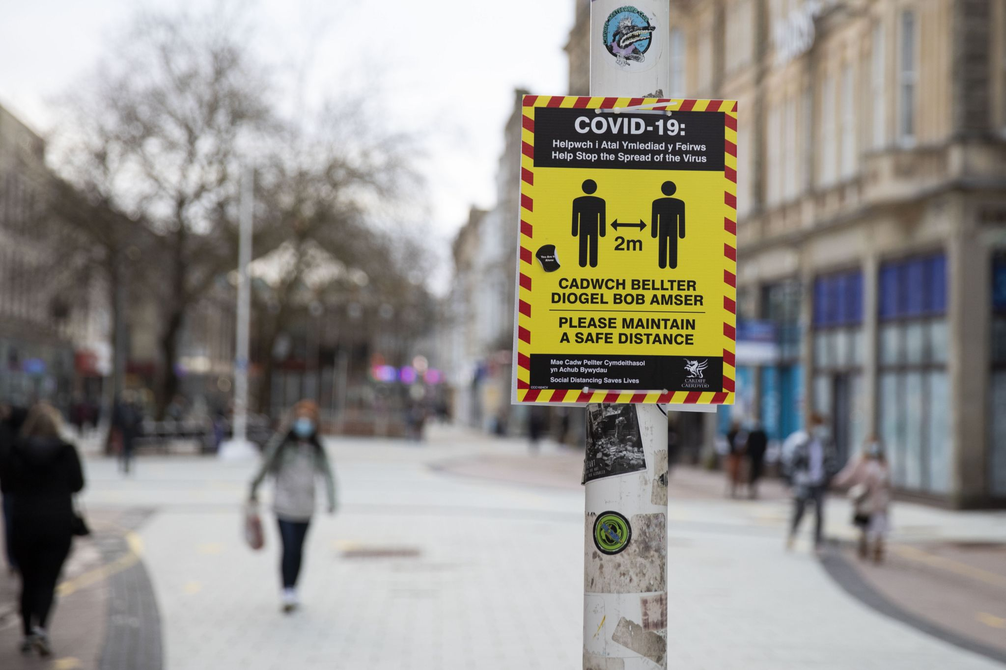 A Covid social distancing sign in Cardiff