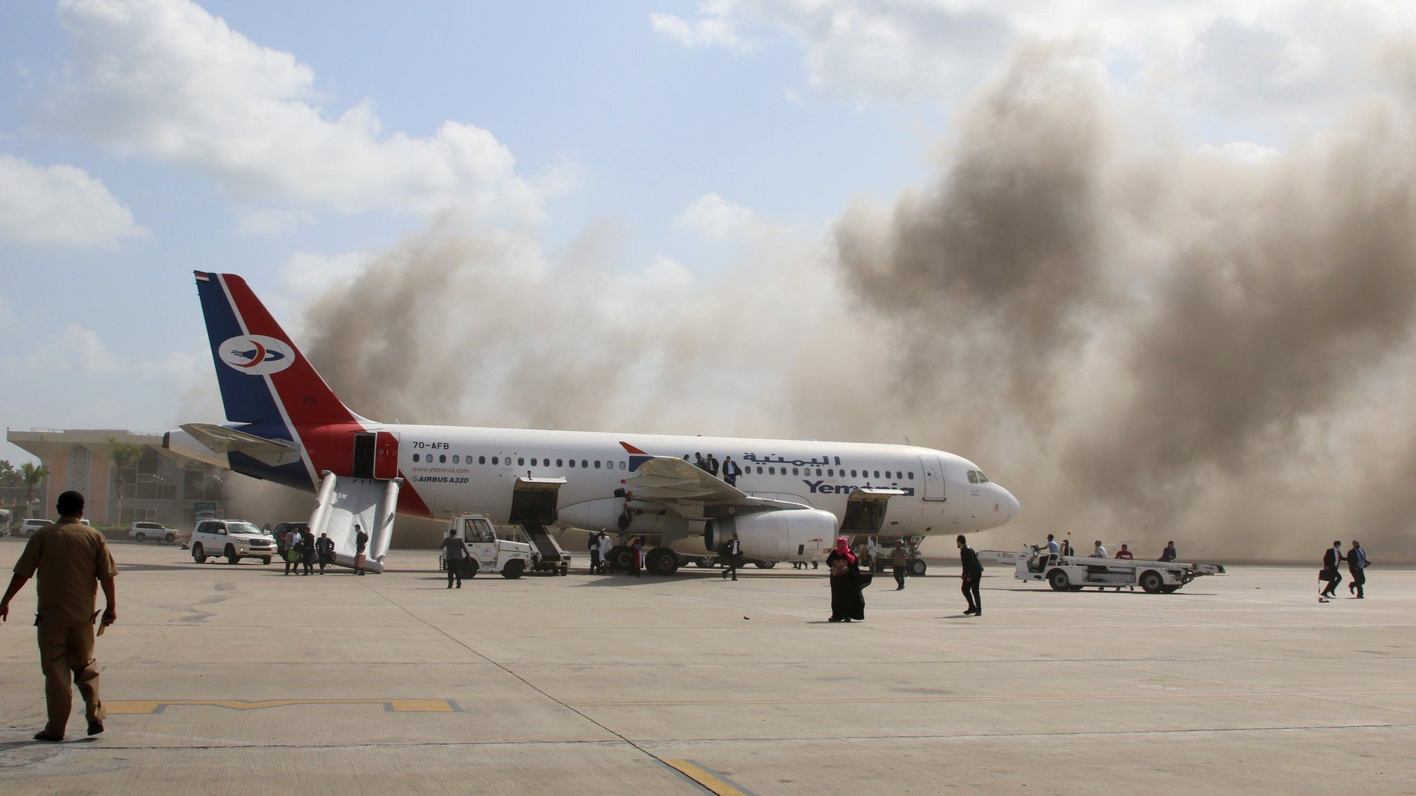 Smoke rises from Aden's airport after an explosion on 30 December 2020