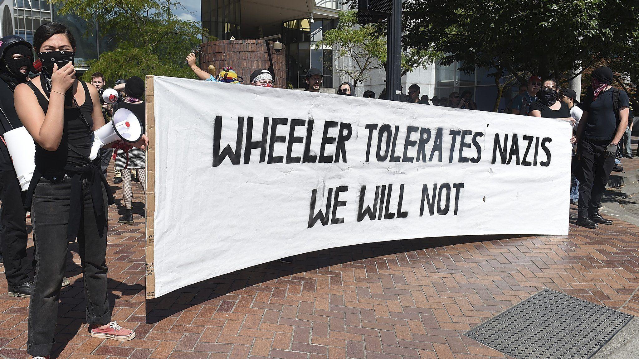 banner: wheeler tolerates Nazis, we will not