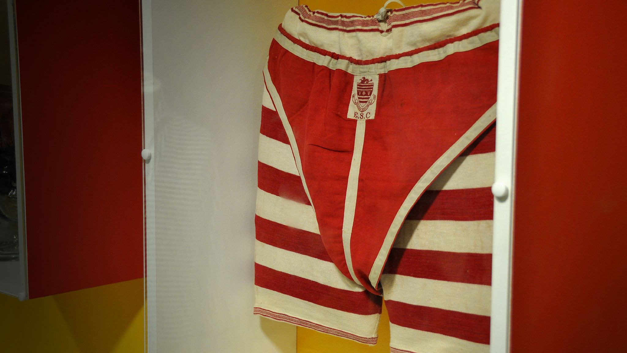 Men's bathing shorts and matching 'athletes' over the top, 1880-1900