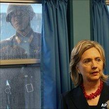 A North Korean soldier watches Mrs Clinton on a visit to the DMZ