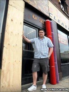 Jon Riley outside his burnt shop front