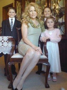 Theresa Riggi with Cecilia and twins Luke and Austin