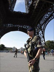 A French soldier patrols around the Eiffel Tower, Paris, 20 September