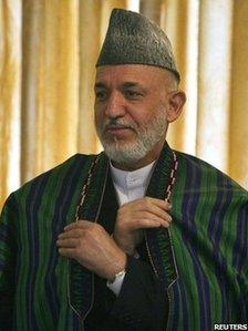 Afghanistan's President Hamid Karzai attends a ceremony promoting senior members of the security forces at the presidential palace in Kabul on 2 October 2010