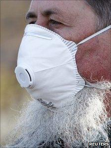 A local man wears a mask to protect himself against the toxic sludge in the village of Devecser, HUngary