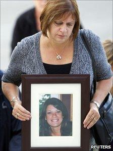 Roxanne Lloyd, mother of murder victim Jessica Lloyd, carries a picture of her daughter as she arrives at Belleville Court, 18 )ct 2010