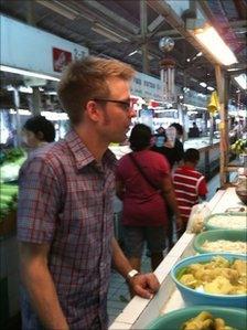 Jarrett Wrisley in a Bangkok market