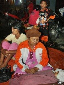 Women and children flee to higher ground in Padang, West Sumatra