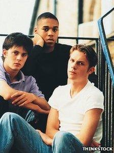 Three youths sitting on stairs