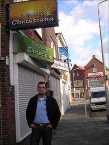 Ben van der Hoeven outside a closed coffee shop in Molenstraat, Rosendaal