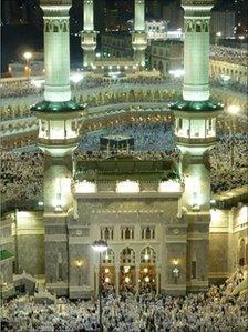 Muslim pilgrims pray around the Grand Mosque in Mecca on November 12, 2010