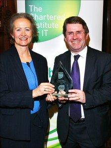 Elizabeth Sparrow, President of BCS, the Chartered Institute for IT, presents Kevin Brennan MP with his social media award