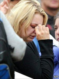 A woman weeps amid family and friends of the 29 coal miners who are trapped underground after an explosion near Greymouth in New Zealand, 21 November 21 2010