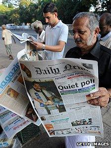 Newspaper readers in Sri Lanka