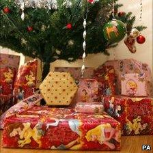 A Christmas tree with presents under it