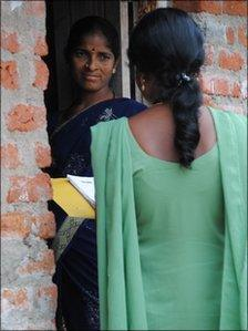 Microfinance field worker and customer