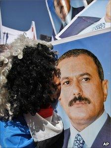 A supporter of President Saleh kisses his portrait in Sanaa, 3 February