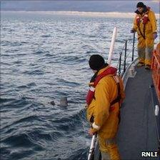 Lifeboat crew recovering wreckage