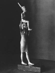 Statue of Tutankhamun carried by a goddess (photo: Griffith Institute)