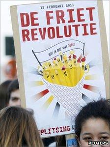 "placard saying ""chips revolution"" (17 Feb 2011)"