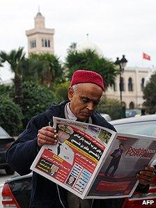 Tunisian newspaper reader