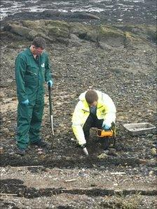 Sepa officers searching for radioactive particles on Dalgety Bay beach Pic John Easton