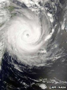 An image released by the Nasa Earth Observatory and taken on 13 February 2012 of Tropical Cyclone Giovanna located about 250 nautical miles (465km) east of Antananarivo, Madagascar