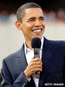 Barack Obama speaking from the stage at a campaign event at the William Bryce Football Stadium on December 9, 2007