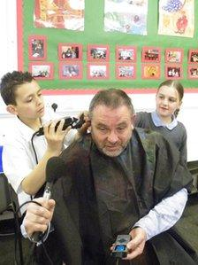 Huw Williams getting haircut from Brandon and Bobbi