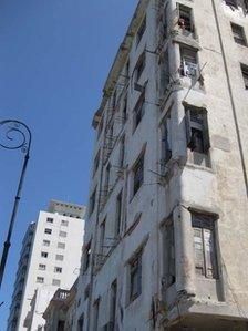 Apartment building number 69 on the Malecon with crumbling facade