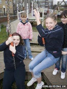 Girl guides playing in the park