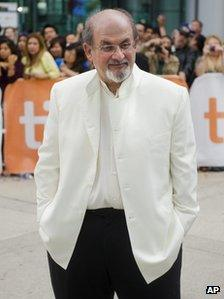 """Author Salman Rushdie poses for photographs on the red carpet for the new movie """"Midnight""""s Children"""" during the 37th annual Toronto International Film Festival in Toronto on Sunday, Sept. 9, 2012."""