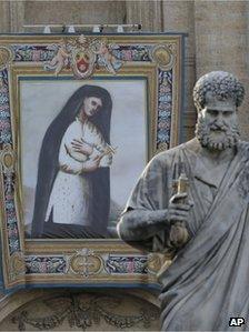 A tapestry of Kateri Tekakwitha hangs on St Peter's Basilica, 19 October
