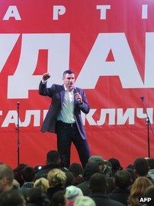 Ukrainian heavyweight boxing superstar Vitali Klitschko gestures during a campaign rally outside Kiev on October 25
