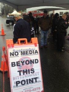 Media hold near the firehouse at Sandy Hook