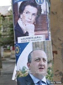 Pre-election posters of presidential candidates Nino Burjanadze (top) and Georgy Margvelashvili in Tbilisi, October 23, 2013.