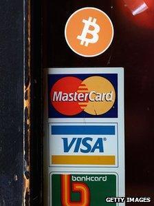 Bitcoin logo on shop door