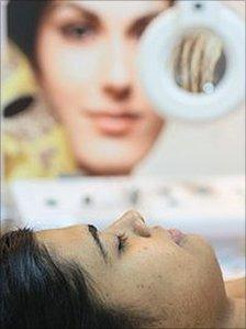 Indian woman receiving skin lightening treatment
