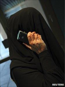 A woman talks on her mobile phone in Dubai