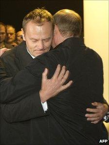 Poland's Prime Minister Donald Tusk and Russian Prime Minister Vladimir Putin hug at the funeral of Polish President Lech Kaczynski who died in a plane crash earlier this year - picture courtesy of Alexey Nikolsky/AFP/Getty Images