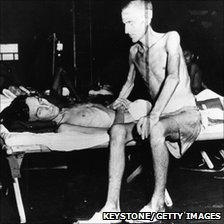 Two emaciated soldiers liberated from a prison camp on Formosa in November 1945
