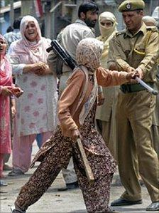 A Kashmiri woman engaged in a scuffle with security forces