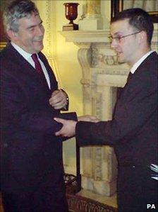 Dan Glass glues himself to Gordon Brown in July 2008