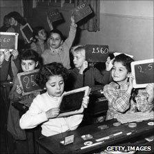 Children hold up slates