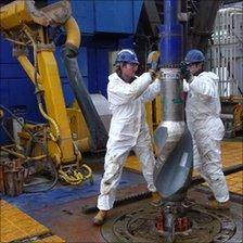 Workers on the F3-FA installation